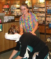 Sandra providing chair massage at Nordstrom event